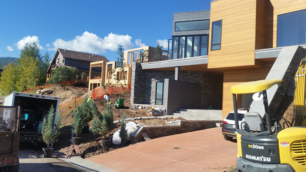 Working on a landscaping job for a modern style home in Utah